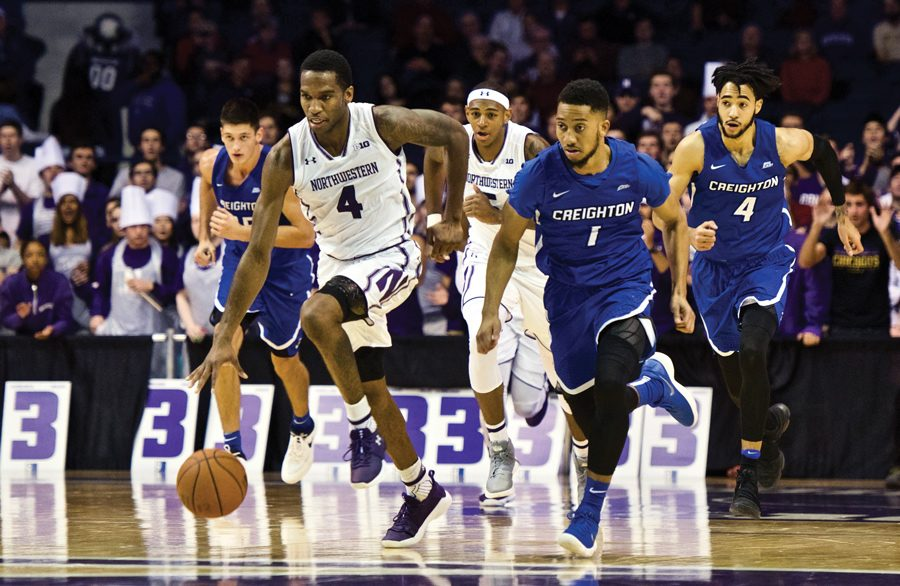 Vic+Law+sprints+away+from+a+defender.+The+junior+forward+scored+a+career-high+30+points+in+the+Wildcats%E2%80%99+loss+to+Creighton+on+Wednesday.