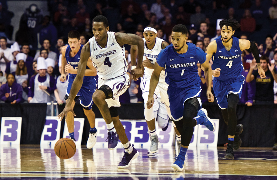 Vic Law sprints away from a defender. The junior forward scored a career-high 30 points in the Wildcats' loss to Creighton on Wednesday.