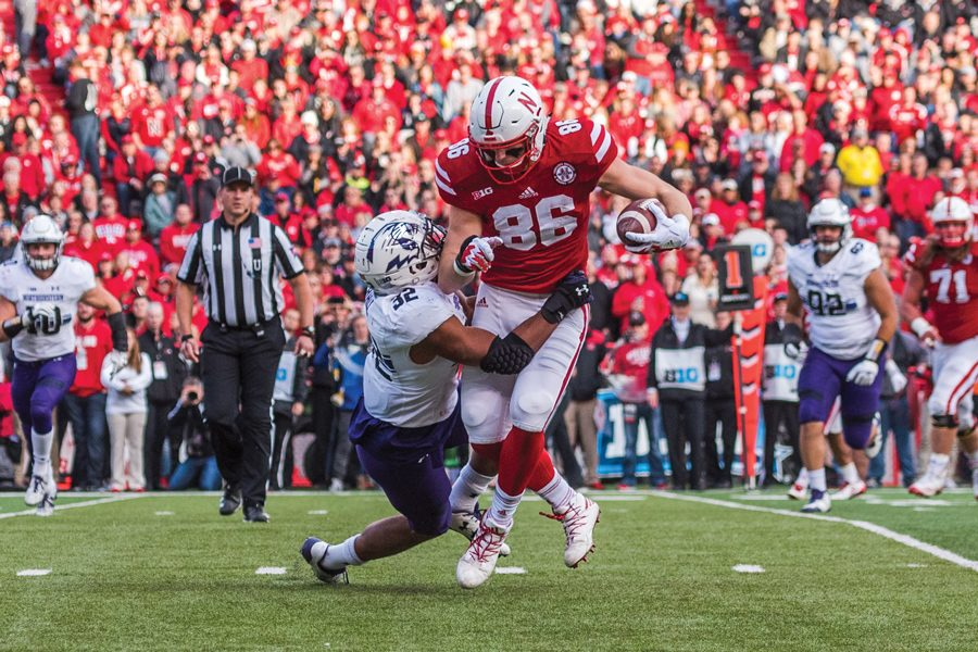Nate Hall makes a tackle. The junior linebacker was named Big Ten Defensive Player of the Week on Monday.