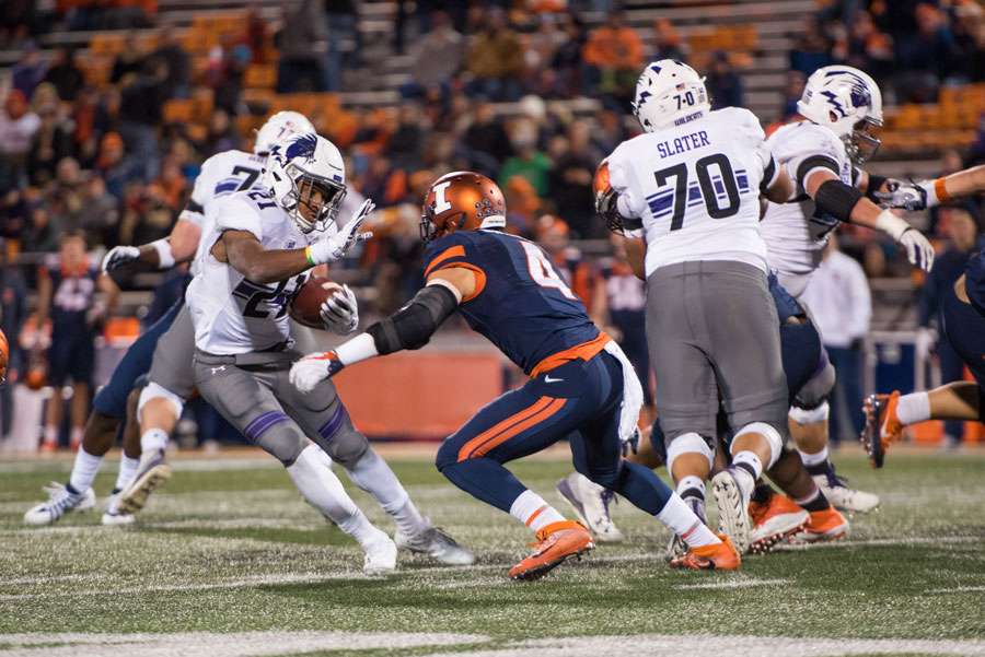 Justin Jackson jukes. The senior running back picked up 144 rushing yards against Illinois on Saturday.
