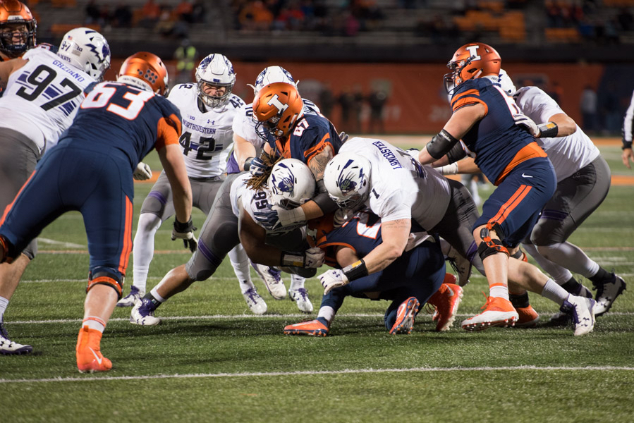 Illinois DL Tito Odenigbo ejected after hitting official with flag
