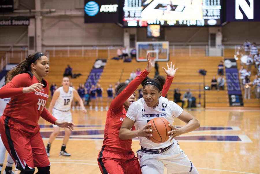 Amber Jamison fights off a defender. The junior guard will look to take on a primary scoring role after the departure of Nia Coffey.