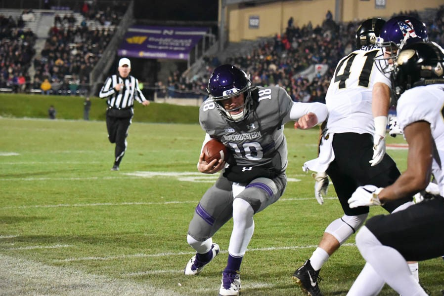 Clayton+Thorson+runs+to+the+boundary.+The+junior+quarterback+had+one+passing+touchdown+and+one+rushing+touchdown+in+Northwestern%27s+victory+over+Purdue+on+Saturday.