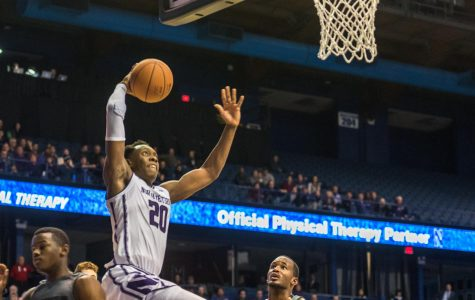 Men's Basketball: Northwestern sneaks by Loyola Maryland in trying season-opening win