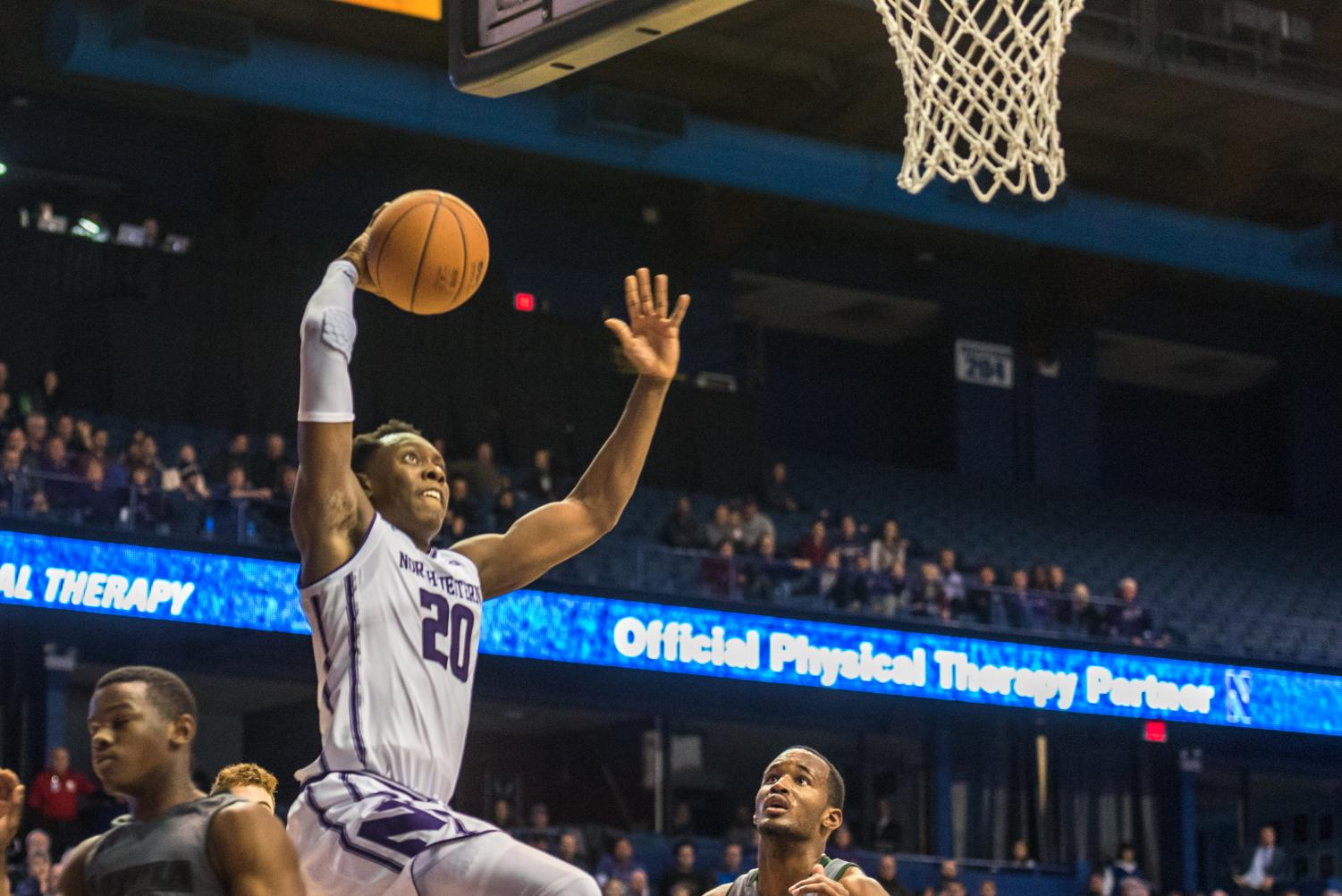 Scottie Lindsey rises for a dunk. The senior guard led all scorers with 26 points as the Wildcats survived Loyola Maryland on Friday.