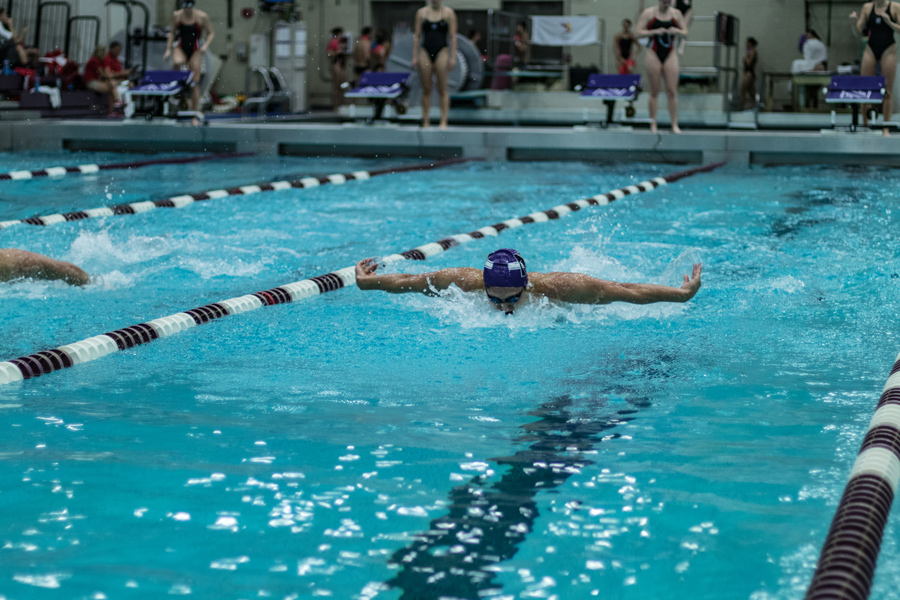 A Northwestern swimmer plows through the water. The Wildcats will host the TYR Invitational this weekend.