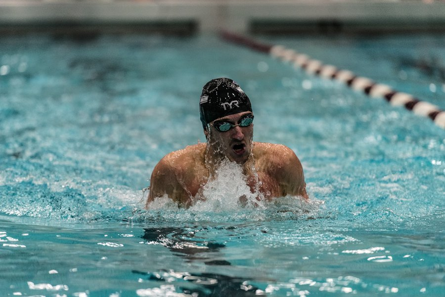 A Northwestern swimmer races. The Wildcats will take on Wisconsin on Saturday.