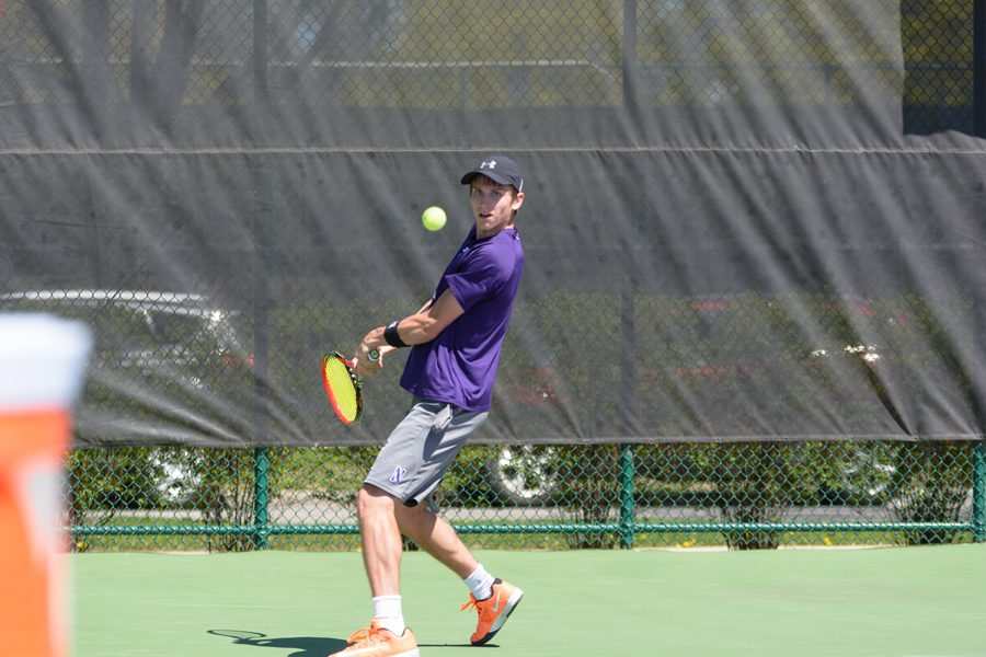 Ben+Vandixhorn+goes+to+his+backhand.+The+junior+and+the+Wildcats+competed+in+several+tournaments+during+the+fall.+