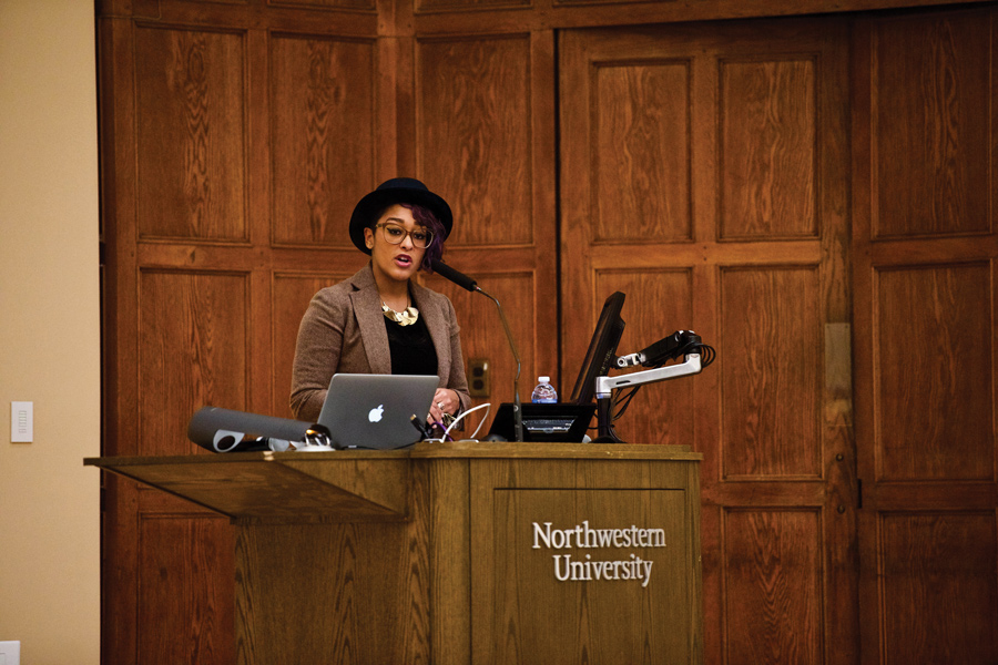 Poet Eve Ewing speaks to students at a Northwestern Community Development Core event in Lutkin Hall on Tuesday. Ewing discussed how her poetry relates to social issues, including education and racial discrimination.
