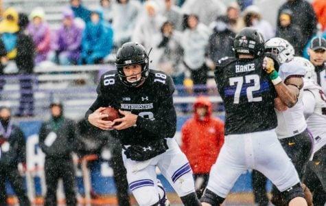 Clayton Thorson runs through the sleet. The junior quarterback passed 13 times at soggy Ryan Field on Saturday.