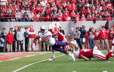 Justin Jackson dives into the end zone. The senior running back ran for 154 yards against Nebraska.