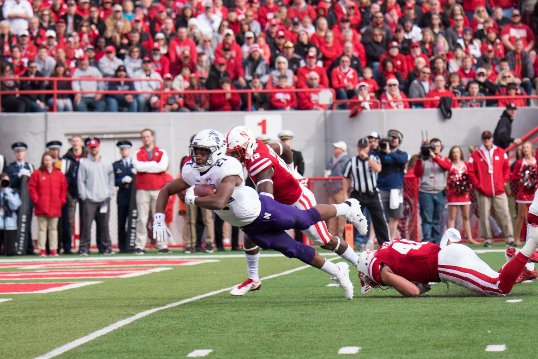 Justin Jackson dives into the end zone. The senior running back ran for 154 yards against Nebraska.