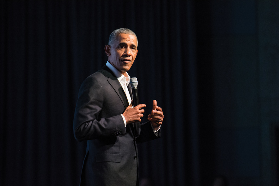 Barack Obama speaks during the Opening Session of the Obama Foundation Summit. During his speech, he said it is important to support young community leaders so that they can expand their influence beyond their local roots.