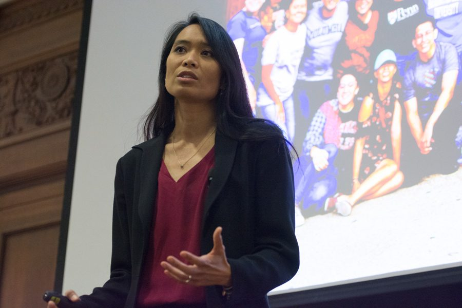 Ana Rowena McCullough, co-founder and CEO of QuestBridge, speaks at an event in Harris Hall on Wednesday. McCullough, who was a first-generation college student, emphasized the importance of higher education.