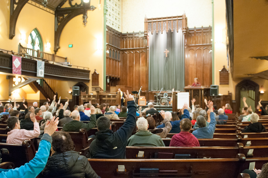 U.S. Rep. Jan Schakowsky (D-Ill.) speaks at an interfaith rally on Sunday. The event encouraged solidarity in the face of discrimination and prejudice.