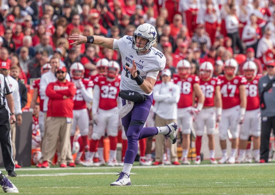 Clayton+Thorson+fires+a+pass.+The+junior+quarterback+shook+off+a+number+of+mistakes+to+lead+the+Wildcats+to+their+victory+over+Nebraska.