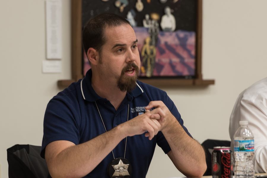 Detective Christopher Tortorello speaks at an Evanston Police Department town hall at the Lorraine H. Morton Civic Center on Thursday. Tortorello and two other officers talked about drugs, gangs and unsolved homicides.