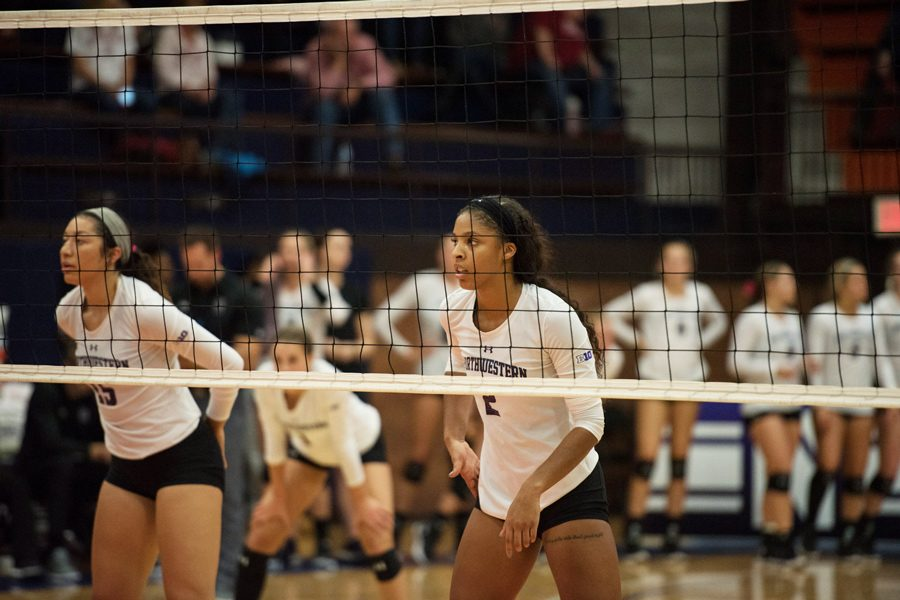 Symone+Abbott+readies+for+a+point.+The+senior+outside+hitter+and+the+Wildcats+split+two+weekend+games+against+Michigan+and+Michigan+State.+%0A