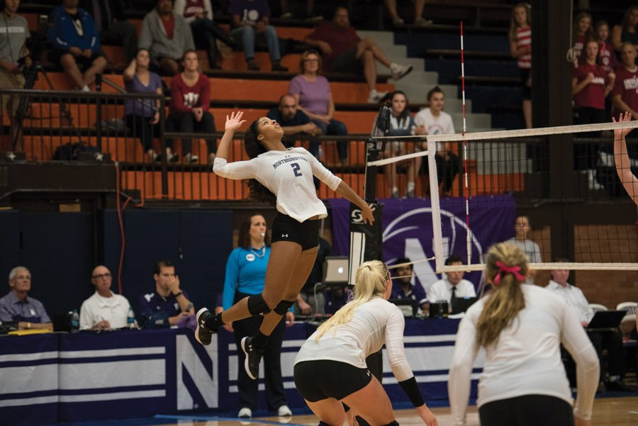 Symone Abbott goes up for a kill. The senior outside hitter and the Wildcats fell 3-0 to No. 9 Michigan State on Saturday.