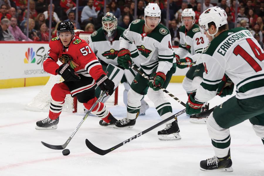 The Chicago Blackhawks' Tommy Wingels (57) battles against a group of Minnesota Wild players in the first period at the United Center in Chicago on Thursday, Oct. 12, 2017. Wingels returned to Chicago to play for the Blackhawks after playing for the San Jose Sharks and the Ottawa Senators.