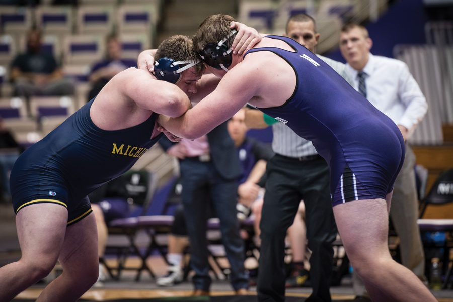 Conan+Jennings+grapples+with+an+opponent.+The+junior+had+a+strong+performance+for+the+Wildcats+at+the+Michigan+State+Open+on+Sunday.+%0A