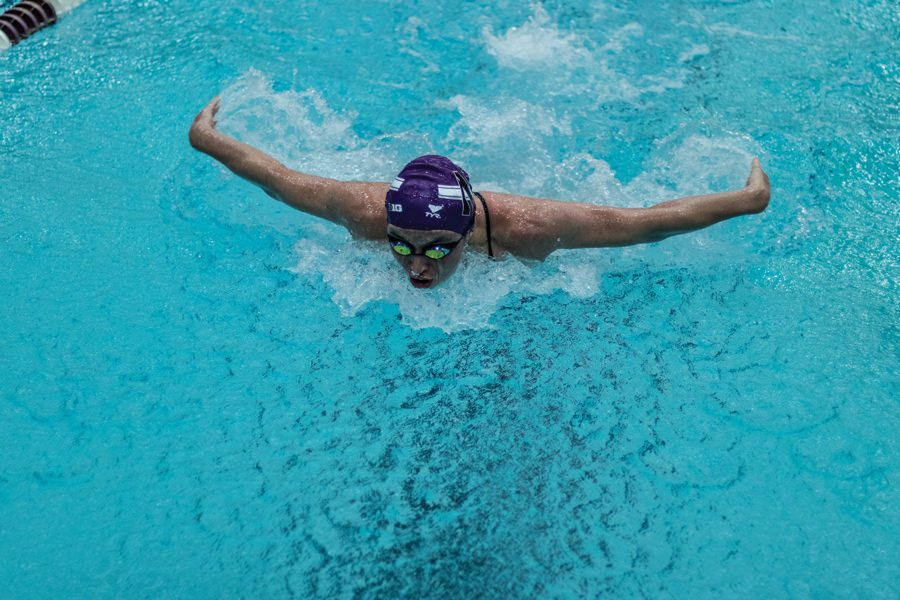 A Northwestern swimmer races. The Wildcats fell to Wisconsin on Saturday.
