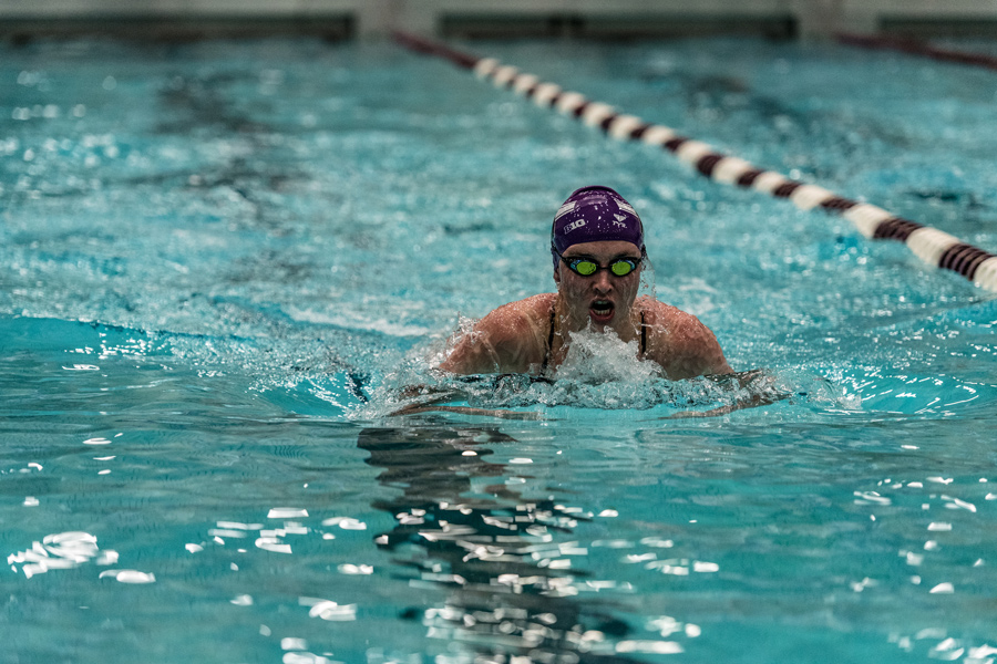 A Northwestern swimmer races. The Wildcats will look to win their second consecutive TYR Invitational this weekend.