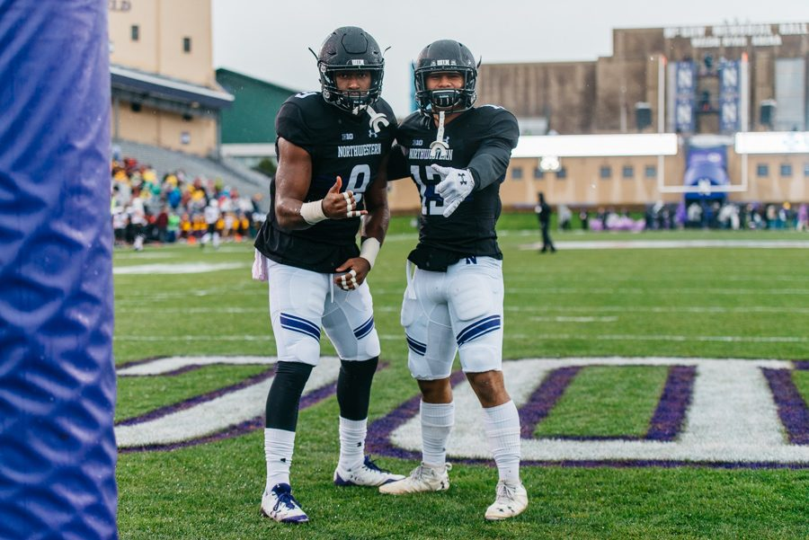 Seniors+Garrett+Dickerson+and+Warren+Long+stand+in+the+end+zone.+Dickerson+caught+a+pair+of+touchdowns+in+NU%27s+dominant+win+over+Minnesota.