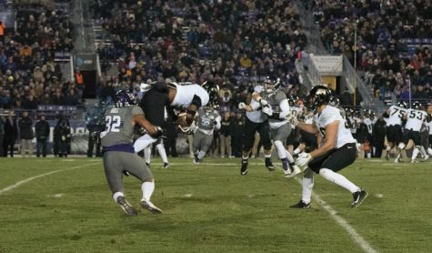 Football: Stifling run defense helps lead Wildcats past Purdue