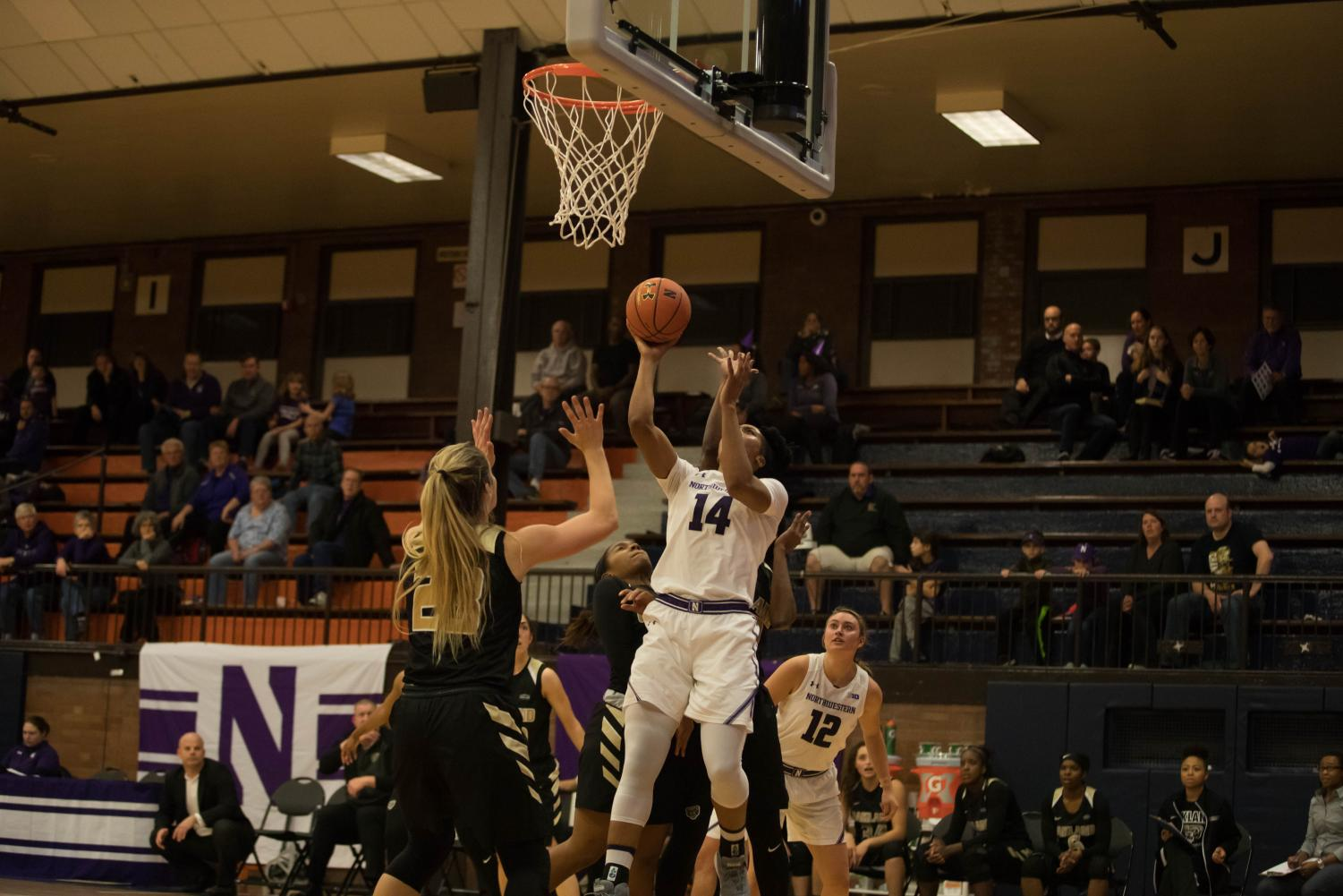 Pallas Kunaiyi-Akpanah goes up for a layup. The junior forward and the Wildcats fell to Syracuse on Thursday.