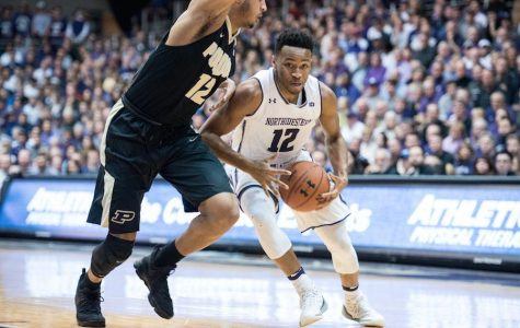 Isiah Brown goes to the hoop. The sophomore guard played a key role in the Wildcats' 62-60 win over DePaul on Saturday.