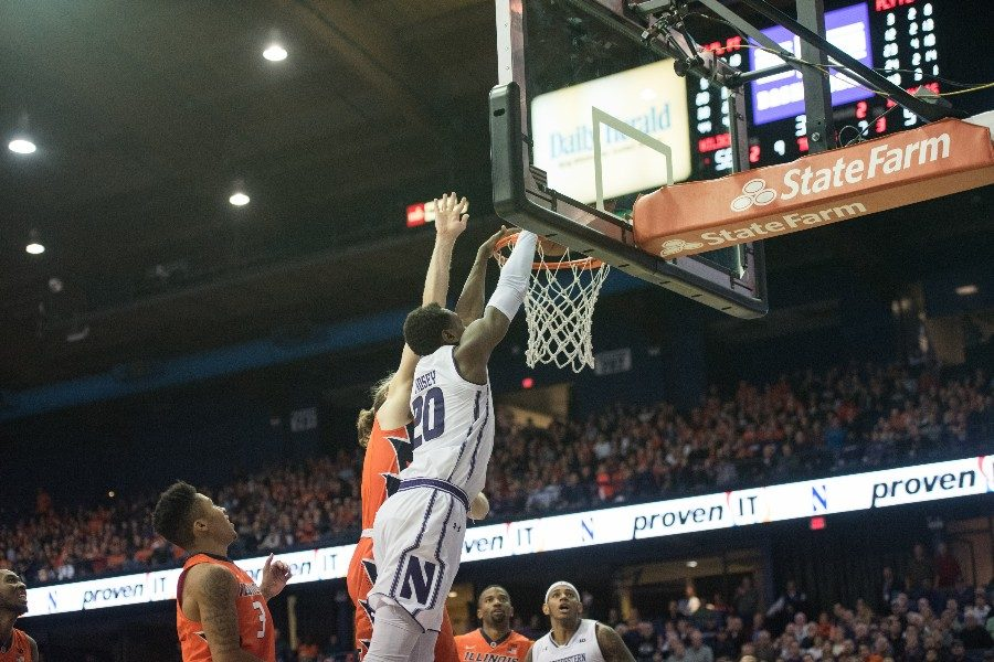 Scottie Lindsey dunks over a defender. The senior guard overcame a slow start to score 22 points in Northwestern's overtime win.