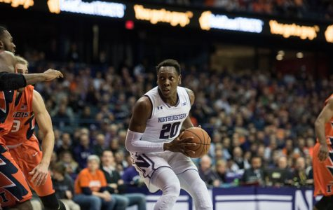 Scottie Lindsey sizes up the defense. The senior guard came off the bench for the first time this season Friday and led Northwestern with 22 points.