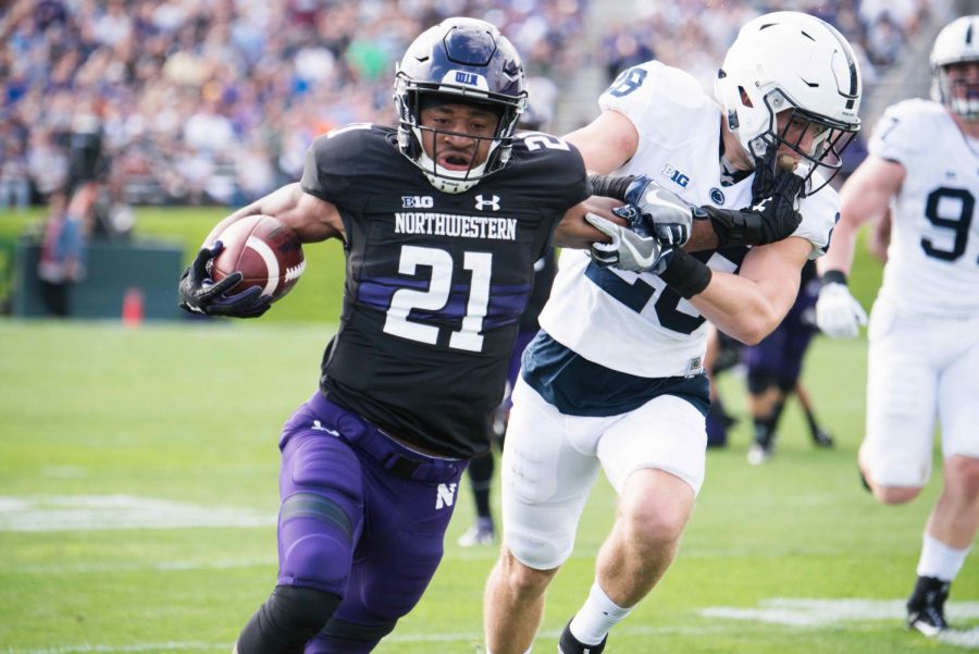 Justin+Jackson+runs+with+the+football.+The+senior+running+back+starred+in+Northwestern%27s+win+over+Pittsburgh+in+the+Pinstripe+Bowl+last+December.+