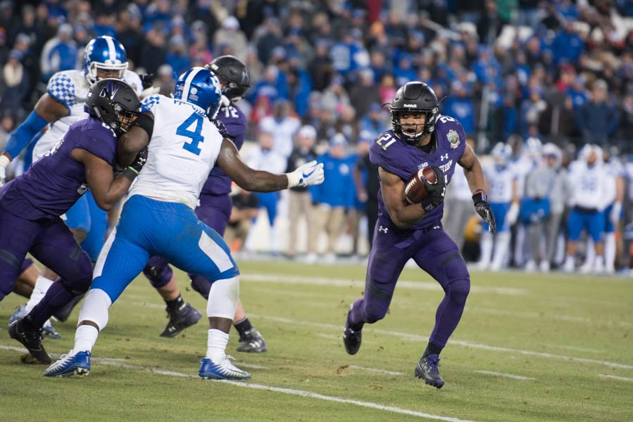 Justin+Jackson+carries+the+ball.+The+senior+running+back+picked+up+157+yards+in+Northwestern%27s+Music+City+Bowl+win.
