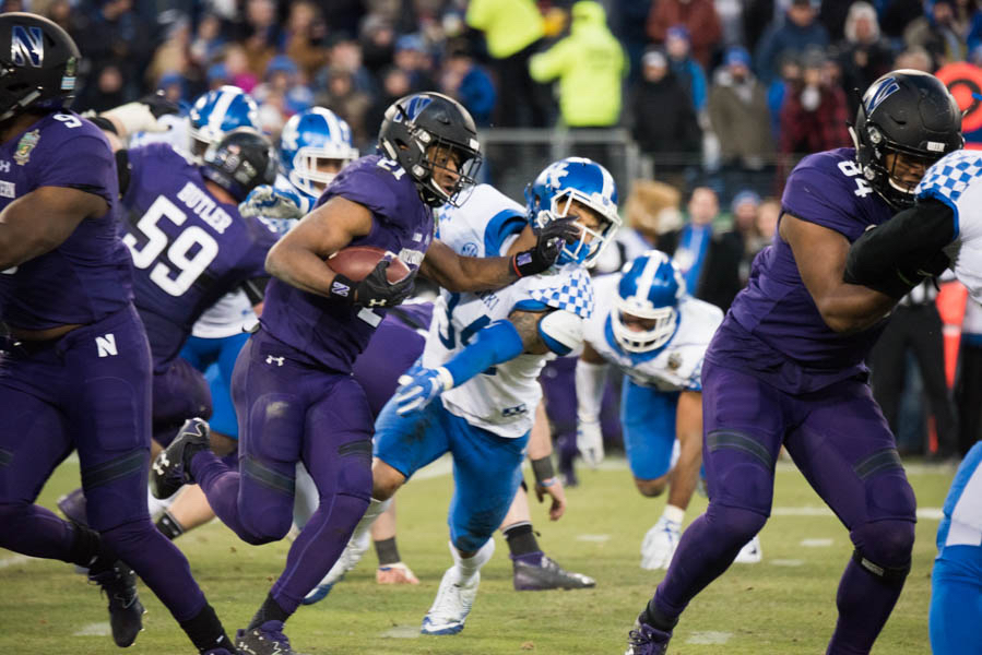 Justin+Jackson+unleashes+a+stiff+arm.+The+senior+running+back+ran+for+a+pair+of+touchdowns+in+Northwestern%27s+Music+City+Bowl+win+Friday.+