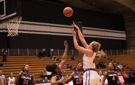 Abi Scheid attempts a shot. The sophomore led Northwestern with 17 points in a 63-57 loss to Green Bay on Tuesday.