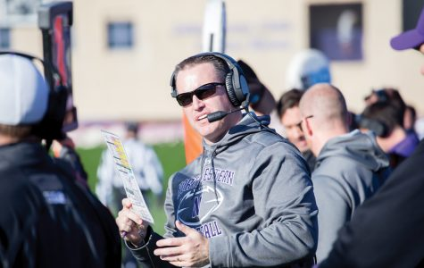 Pat Fitzgerald has a conversation on the sideline. Lou Ayeni is the newest addition to Fitzgerald's staff and is set to serve as running backs coach.