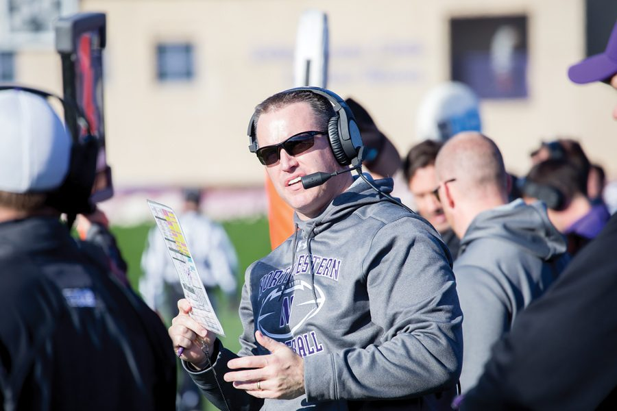 Pat+Fitzgerald+has+a+conversation+on+the+sideline.+Lou+Ayeni+is+the+newest+addition+to+Fitzgerald%E2%80%99s+staff+and+is+set+to+serve+as+running+backs+coach.