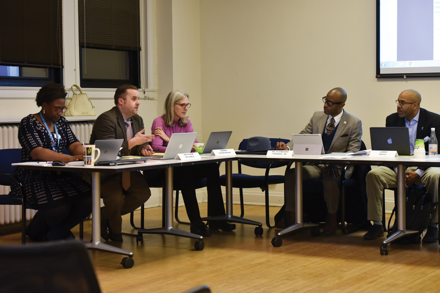 Committee members discuss the police complaint process at a meeting. The committee will release a survey to garner public opinion about the process.