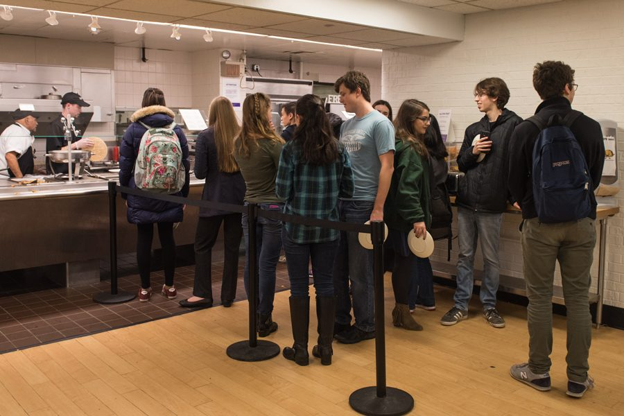 Students+line+up+to+get+food+at+one+of+the+Foster-Walker+Complex+dining+halls.+Students+reported+overcrowding+at+Plex+and+Allison+after+Hinman+and+its+dining+hall+closed+for+renovations.+
