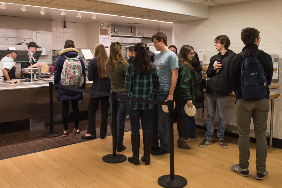 Students line up to get food at one of the Foster-Walker Complex dining halls. Students reported overcrowding at Plex and Allison after Hinman and its dining hall closed for renovations.