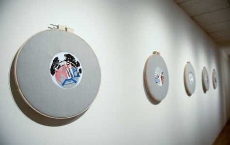Sabba Elahi's art displayed at the Dittmar Gallery. Elahi, whose work explores the intersection of surveillance and domestic life, created both hand-crafted and machine-crafted embroideries.