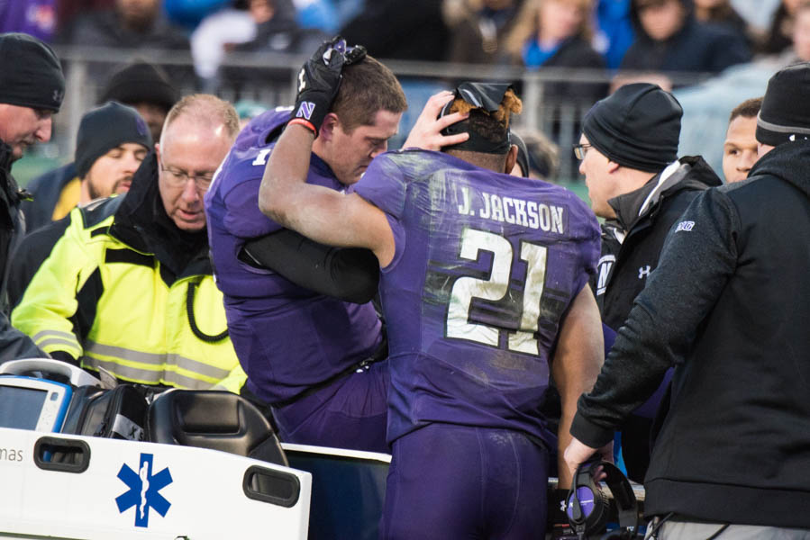 Clayton+Thorson+%28left%29+embraces+Justin+Jackson+as+Thorson+is+carted+off+the+field+in+the+Music+City+Bowl.+Thorson+suffered+a+torn+ACL.