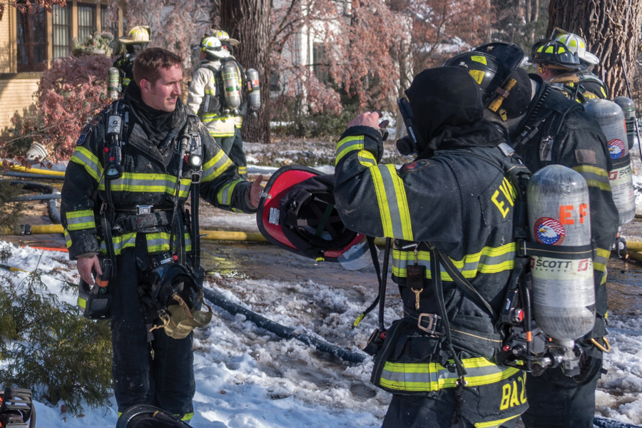 Firefighters fight a blaze in the 2800 block of Sheridan Place. City Council on Monday approved the expansion of a fund that will help the Evanston Fire Department diversify its force.