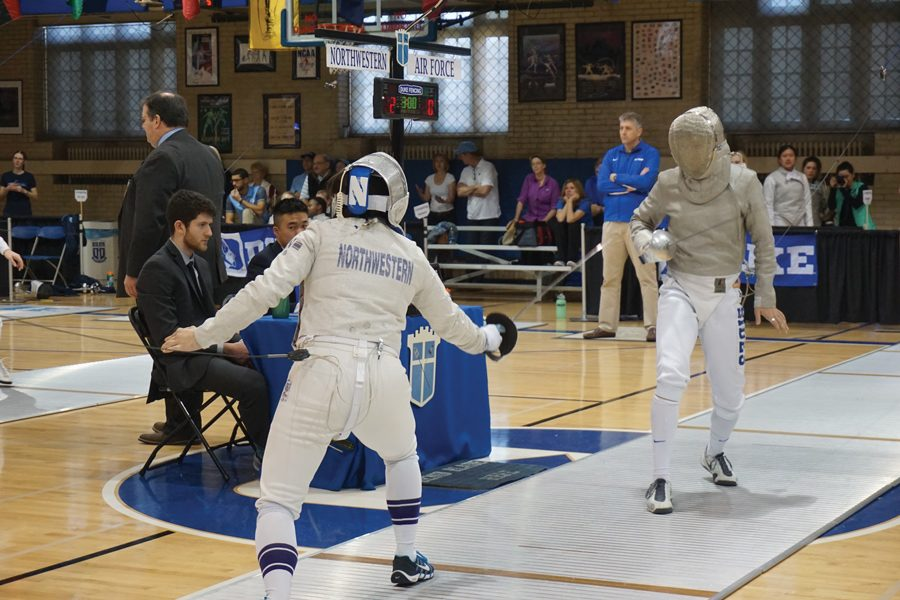 A Northwestern fencer eyes up her opponent. The Wildcats look to pick up some more wins this weekend in the Western Invitational.