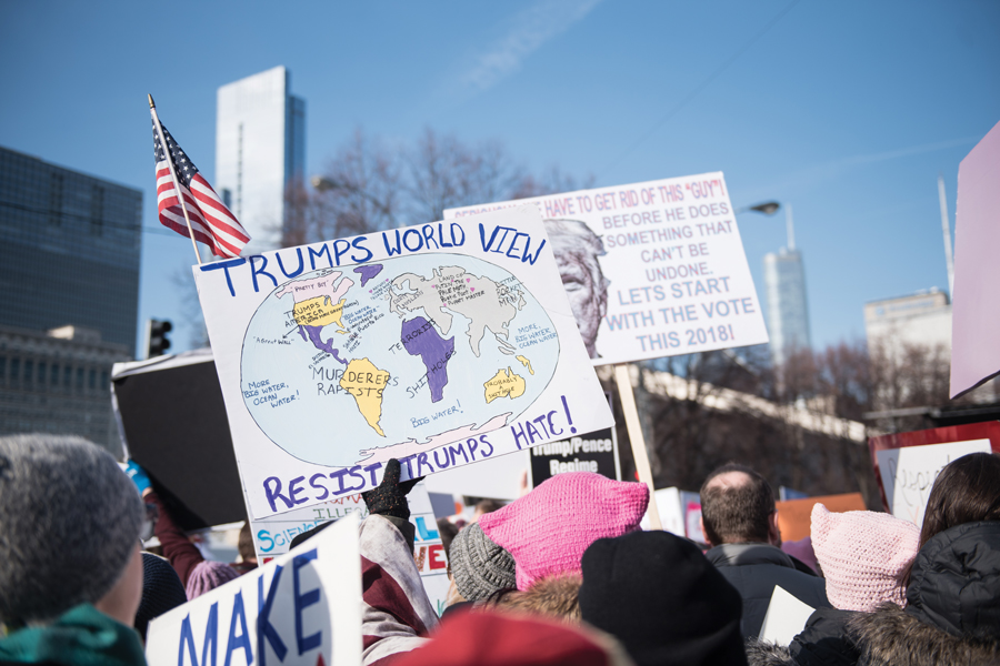 A sign at the 2018 Chicago Women's March. In response to Trump's new immigration policies, Evanston residents gathered on Monday to discuss how to support immigrants.