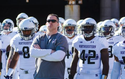 Pat Fitzgerald stands with the football team before a game. Tim McGarigle will join Fitzgerald's staff as safeties coach in 2018.