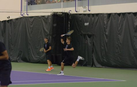 Michael Lorenzini blasts a forehand. The junior lost in the N.C. State match before bouncing back with a victory in Boise.