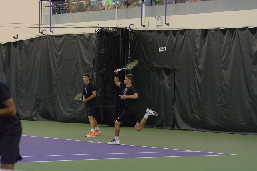Michael+Lorenzini+blasts+a+forehand.+The+junior+lost+in+the+N.C.+State+match+before+bouncing+back+with+a+victory+in+Boise.+